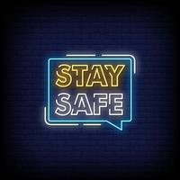 stare al sicuro insegne al neon stile testo vettoriale