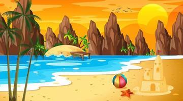 scena di paesaggio spiaggia tropicale con castello di sabbia al tramonto vettore