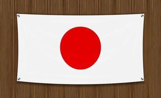 bandiera del Giappone su uno sfondo di parete in legno scuro vettore