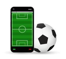 smartphone con un campo da calcio e un pallone da calcio vettore