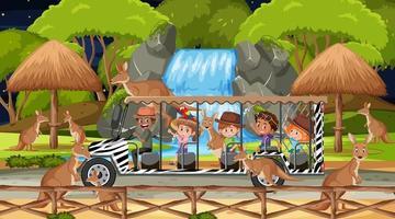 safari in scena notturna con bambini che guardano un gruppo di canguri vettore