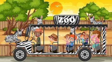 safari alla scena del tramonto con molti bambini che guardano il gruppo di zebre vettore