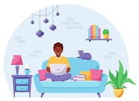 uomo afroamericano seduto su un divano e lavora al computer portatile. libero professionista, concetto di home office. illustrazione vettoriale