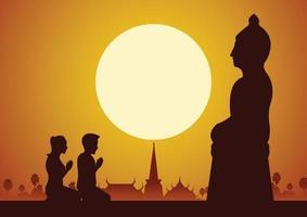 uomo e donna buddisti rispettano la scultura del buddha vettore