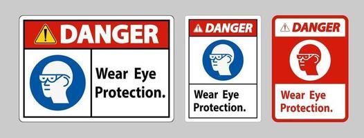 segno di pericolo indossare una protezione per gli occhi su sfondo bianco vettore