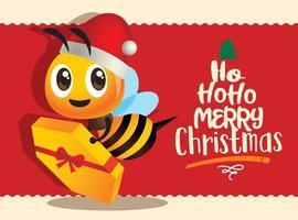 cartone animato carino regalo di consegna ape per la celebrazione di buon Natale con scritte di saluto vettore