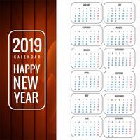 Modello di calendario 2019 con priorità bassa di struttura di legno