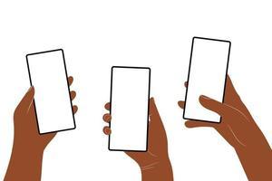 le mani umane tengono il telefono cellulare verticale con lo schermo vuoto vettore