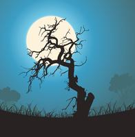 Silhouette albero morto al chiaro di luna vettore