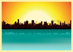 Paesaggio della città al tramonto vettore