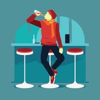 Giovane felice che beve birra da vetro al bar o pub