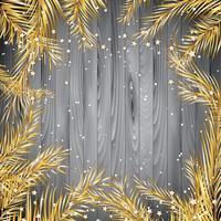 Fondo di Natale con i rami di albero dell'abete dell'oro su un tex di legno
