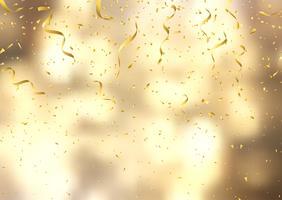 Coriandoli e stelle filanti d'oro su fondo defocussato