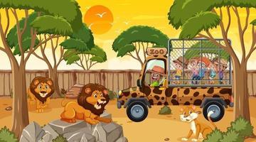 safari alla scena del tramonto con molti bambini che guardano il gruppo di leoni vettore