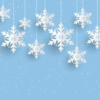 Sfondo di Natale con appesi i fiocchi di neve vettore