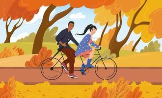 la giovane donna bianca e l'uomo afroamericano vanno in bicicletta in un parco in autunno. illustrazione vettoriale di cartone animato disegnato a mano