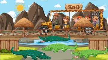 safari nella scena diurna con molti bambini che guardano il gruppo di alligatori vettore