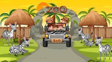 zoo al tramonto con molti bambini che guardano il gruppo di zebre vettore