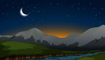 scena di montagna durante la notte vettore