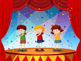 Un gruppo di bambini si esibisce sul palco vettore