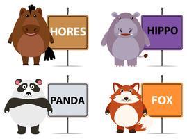 Animali selvaggi e nomi sui segni vettore