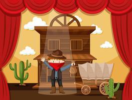 Ragazzo che agisce sul palco con scena di cowboy