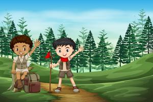 Boy scout nella giungla vettore