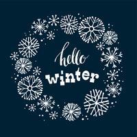 Progettazione di iscrizione di inverno sul fondo della neve con la struttura disegnata a mano del fiocco di neve.