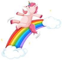 Felice unicorno sulla diapositiva arcobaleno vettore