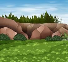Scena di sfondo con rocce ed erba vettore