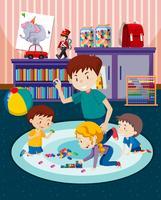 Padre e bambini che giocano con i giocattoli