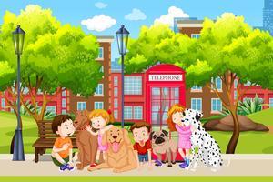 Amante dei cani nel parco vettore