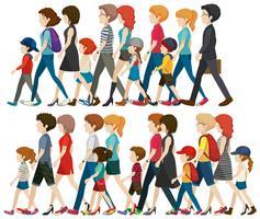 Persone senza volto che camminano in gruppo vettore