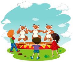 Bambini che guardano la danza di volpe vettore