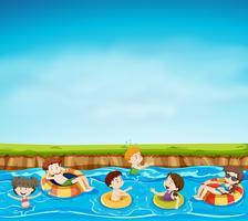 Gruppo di bambini che giocano nel lago vettore