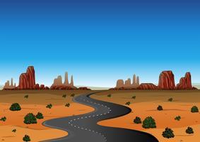 Scena del deserto con strada vuota vettore
