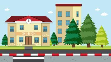 Una scena di edificio scolastico vettore