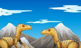 Scena con dinosauri e montagne