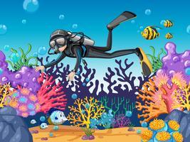 Operatore subacqueo di scuba che si tuffa nella bella scogliera vettore