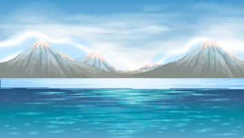 Scena di sfondo con lago blu e montagne