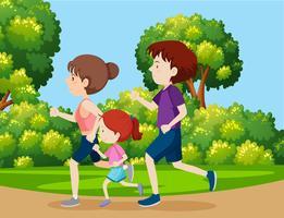 Una famiglia che fa jogging nel parco