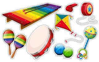 Set di adesivi di strumenti musicali e giocattoli vettore