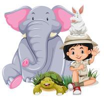 Una ragazza di safari con animali felici