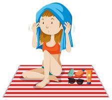 Una ragazza del bikini che si abbronza su priorità bassa bianca