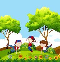bambini che ballano nel parco vettore