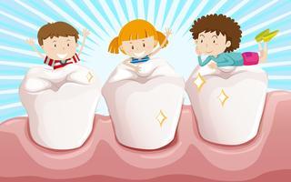 Pulire i denti e bambini felici vettore