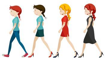 Donne che camminano su sfondo bianco vettore