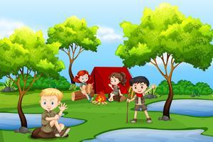 Camping bambini nella foresta vettore