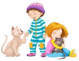 I bambini con i gatti domestici vettore