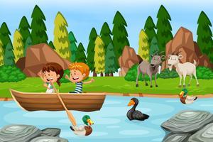 Scena di boschi con bambini e animali vettore